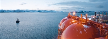 Natural gas liquefaction plant on the Melkoya peninsula off Hammerfest. LNG tanker Arctic Princess docked at the plant in wintertime.